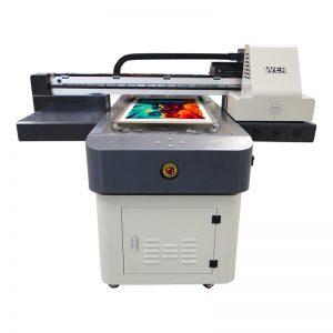 注文のTシャツの印字機が付いている衣服プリンターに直接